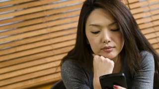 a businesswoman holding a smartphone