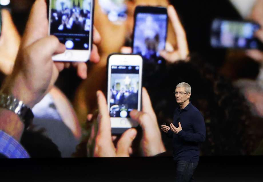 Craig Federighi, Apple senior vice president of software engineering speaks about the HomeKit, which links Internet-connected lights, speakers and locks to Apple devices and Siri. Photo: Jeff Chiu, Associated Press