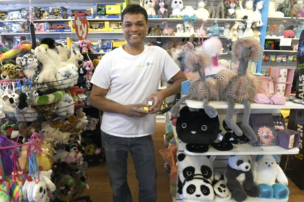 Rohit Meher, owner of Wonderland Toys stands for a portrait in front of some of the unique toys, that he offers at his store on April 16, 2018 in Highlands Ranch.