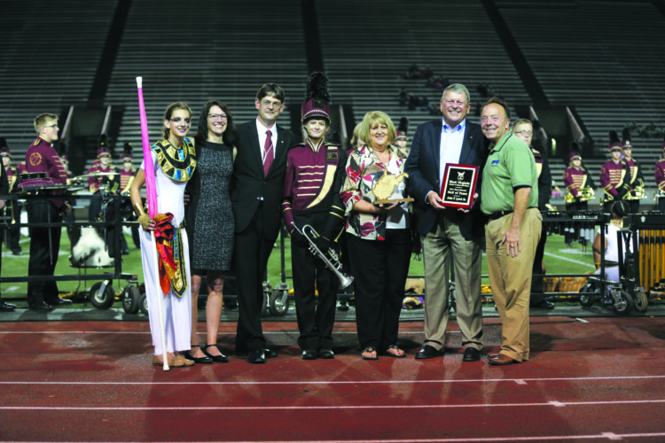 12MarchBand HOF10-21-17From left: Anna Lynch, Dawn Lynch, J.P. Lynch, Emma Lynch Rosemary Lynch, John Lynch and Randall Reid-Smith. WV Comissioner of the Division of Culture and History presenting John Lynch Sr. wit the 2017 Band Director Hall of Fame Plaque at Laidley Field in Charleston, WV Oct. 21, 2017. (Submitted Photo by Marcus Constantino)