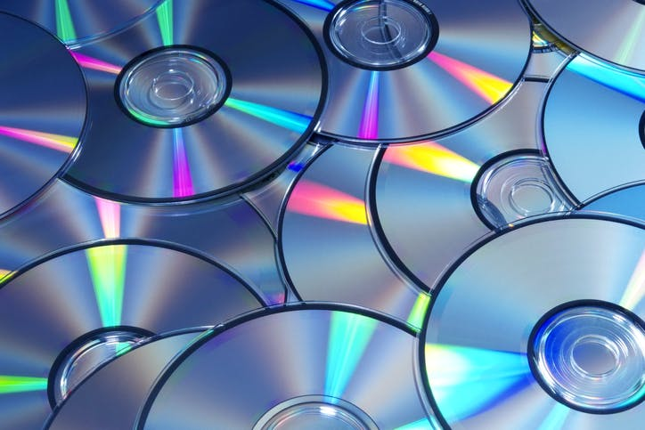 High angle view and blue tinted image of DVDs